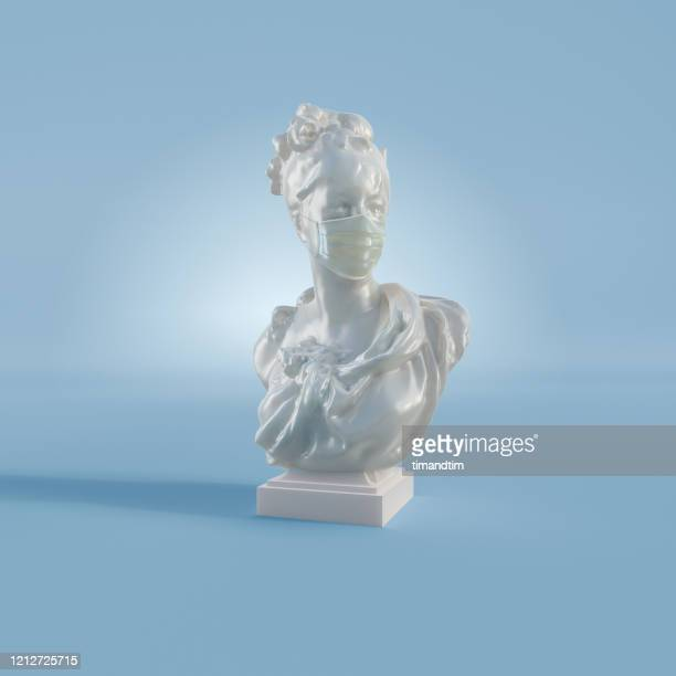 old statue of a woman wearing a mask - sculpture stock pictures, royalty-free photos & images