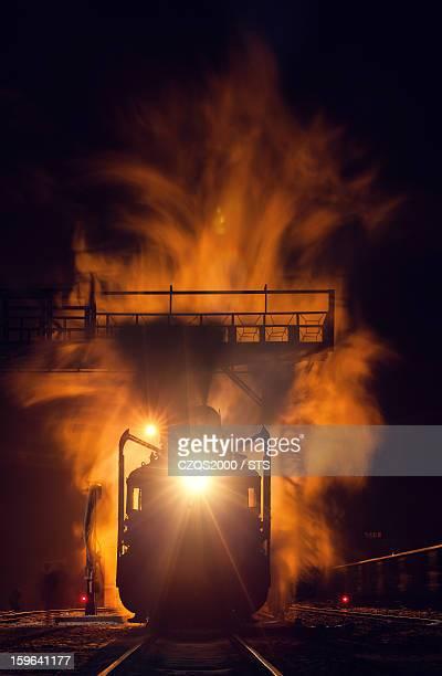 Old steam locomotive at night