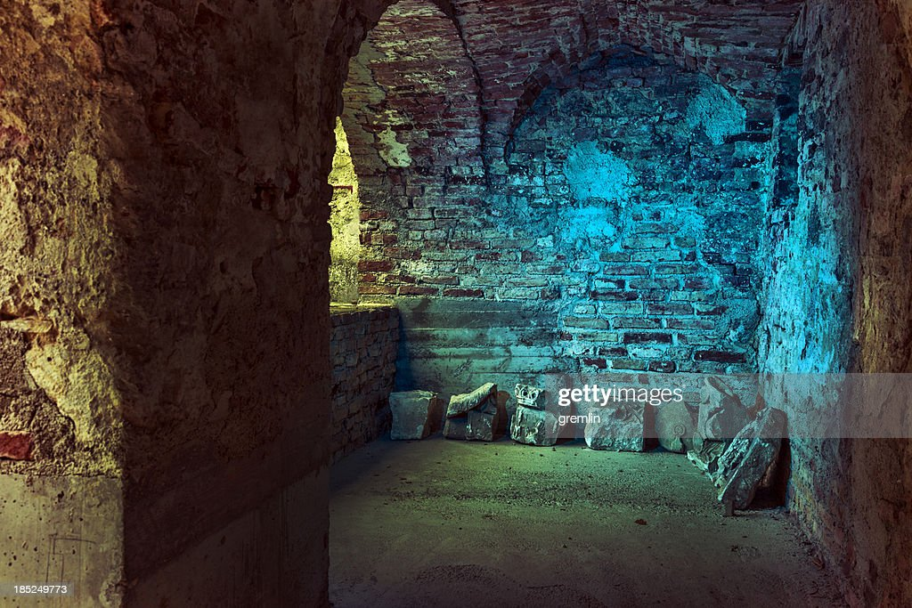 Old stone arcades in a derelict, abandoned castle : Stock Photo