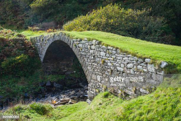 Old stone arch bridge at Latheron Harbor in Scottish Highlands