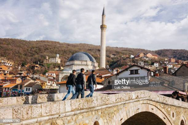 old stone bridge and sinan pasha mosque in prizren - dafos stock photos and pictures