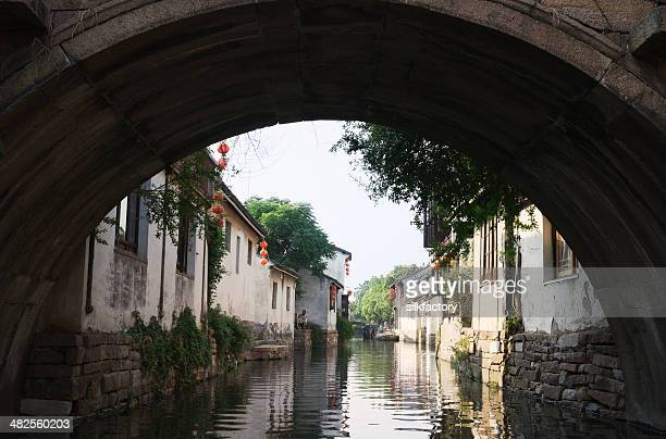 Old stone bridge over canal in Zhouzhuang Water Town