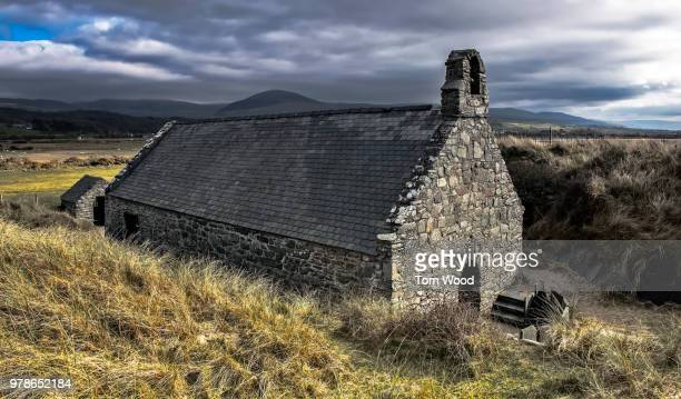 Old stone church under dramatic sky, Snowdonia, Gwynedd, Wales