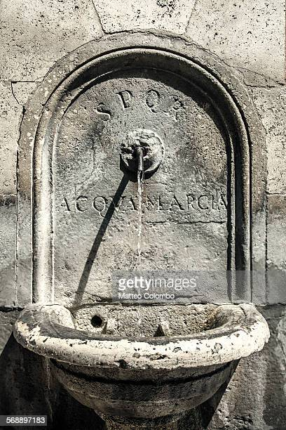 Old stone fountain close up, Rome, Italy