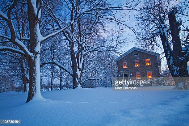 Old stone house in snow