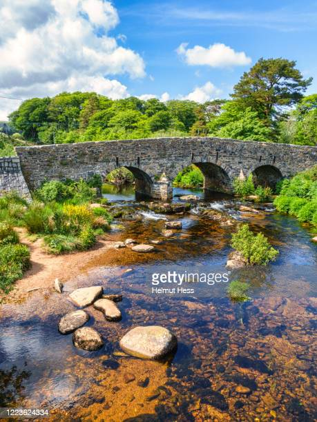 old stone slab bridge at postbridge - south stock pictures, royalty-free photos & images