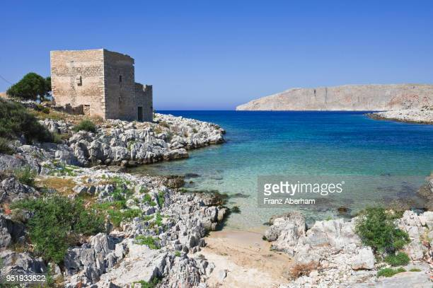 old stone tower in bay near gerolimenas, mani, greece - peloponnese stock photos and pictures