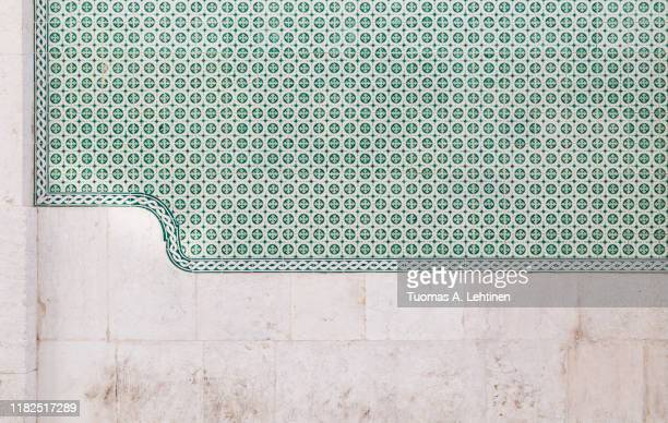 old stone wall and green ceramic tiles (azulejos) in lisbon, portugal. high resolution full frame textured background. - traditionally portuguese stock pictures, royalty-free photos & images