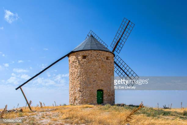 old stone windmill - traditional windmill stock photos and pictures