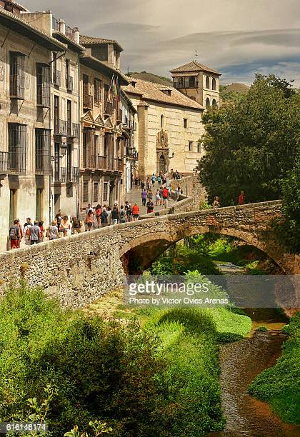 Old street and bridge over Darro river in the Albaicin in Granada