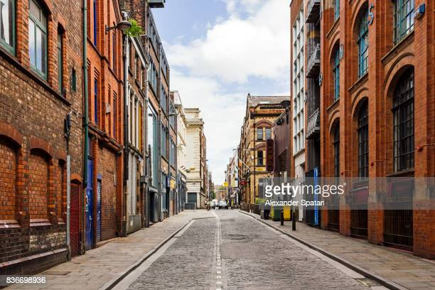 Old street with brick wall buildings in the downtown of Liverpool, England, UK