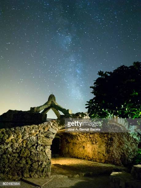 Old structure in form of cupula with arches a night of sky with stars with the milky way. Valencian Community, Spain.