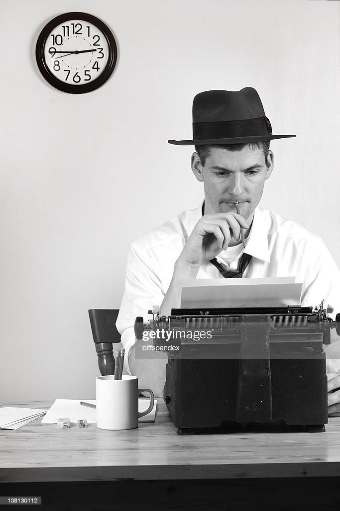 Old Style Man Reporter Sitting at Typewriter, Black and White : Stock Photo