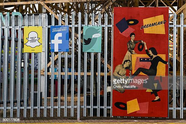Old style signs next to Snapchat Facebook and Twitter signs under the wooden rollercoaster Scenic Railway at Dreamland Margate during the start of...