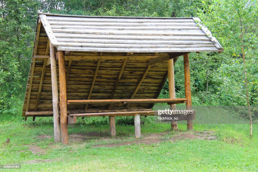 Old Style Wooden Canopy With Bench In Forest Park Stock Photo