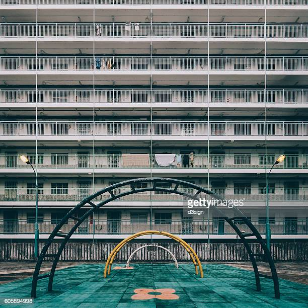 Old styled playground with public housing estates in Hong Kong.