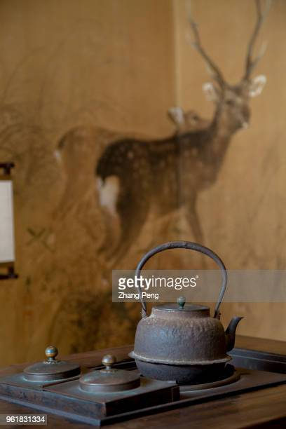 Old styled tea pot and screen painting also known as 'machiya' is the landmark building and tourist attraction of Nara old street which reproduces...