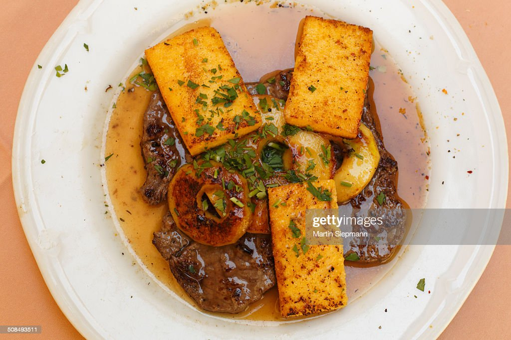 Old Styrian apple roast with polenta slices, Graz, Styria, Austria, Europe : Foto de stock