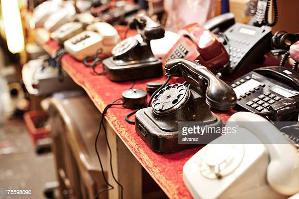 old telephones in a row - garage sale stock pictures, royalty-free photos & images