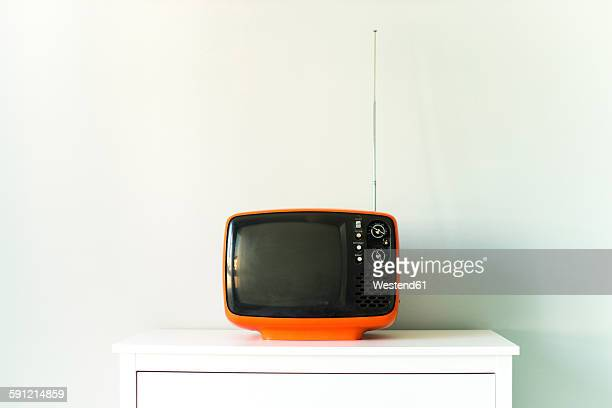 Old television on chest of drawers