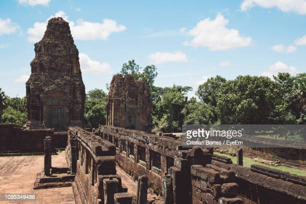 old temple and trees against sky - bortes stock pictures, royalty-free photos & images