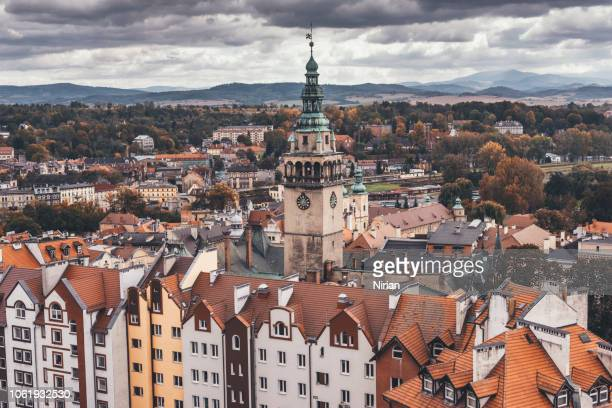 old tenement houses with a town hall tower above them - silesia stock pictures, royalty-free photos & images