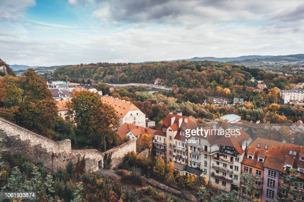 old tenements and a fragment of the fortress wall - silesia stock pictures, royalty-free photos & images