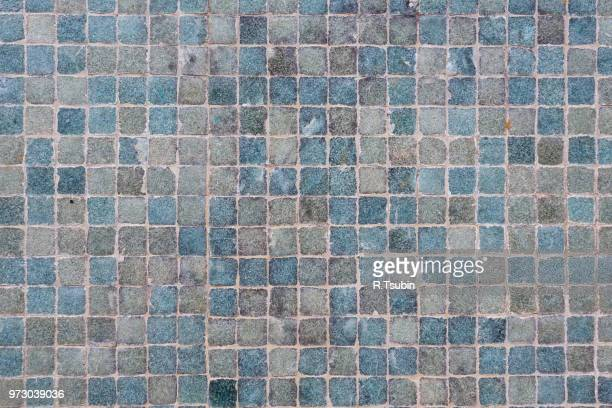 Old textured background of blue wall tiles