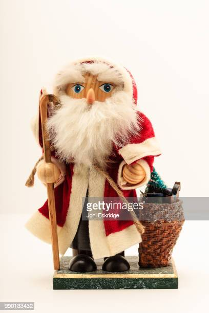 Old Time Wooden Santa on White Background
