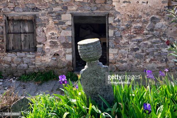 old tombstone and wildflowers at barbaros village. - emreturanphoto stock pictures, royalty-free photos & images