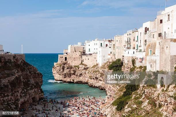 old town and beach, polignano a mare, apulia, italy - apulien stock-fotos und bilder