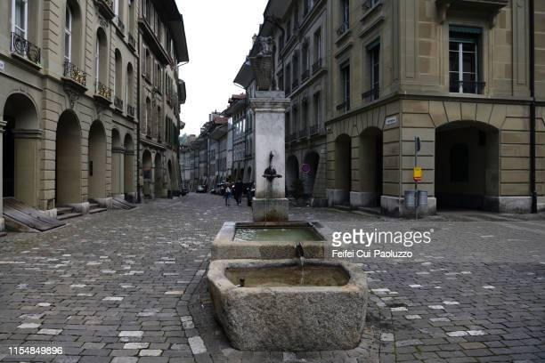 old town bern and old water funtain, switzerland - bern stock photos and pictures