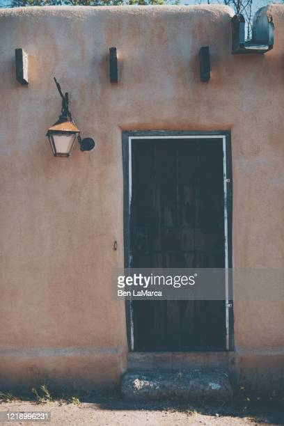 old town black door with vigas - adobe stock pictures, royalty-free photos & images