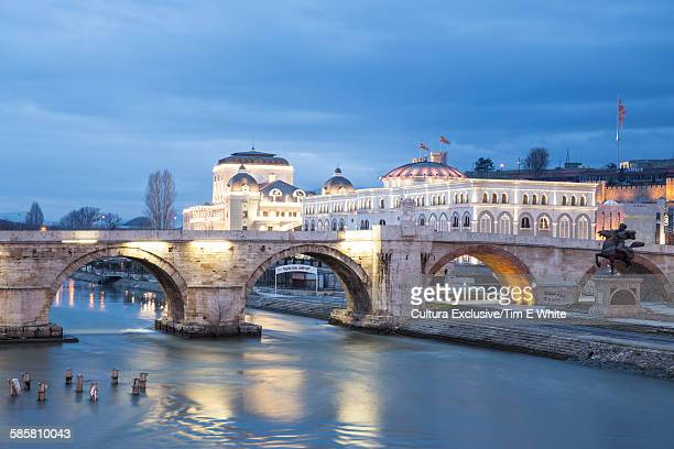 old town bridge and cityscape at dusk, skopje, macedonia - skopje stock pictures, royalty-free photos & images