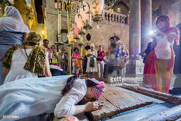 Old Town, Christian Quarter, Church of the Holy Sepulchre (also called the Basilica of the Holy Sepulchre), people near the Stone of Anointing
