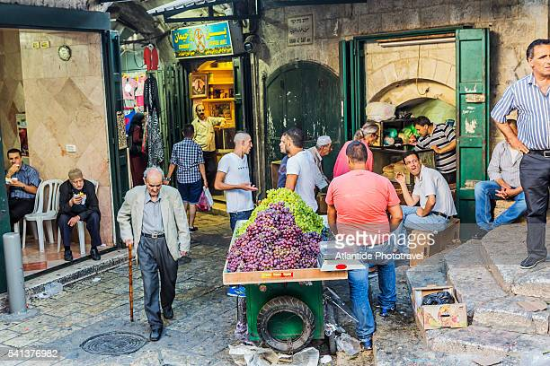 old town, muslim quarter, greengrocer in souq khan el-zeit street - israeli ethnicity stock pictures, royalty-free photos & images