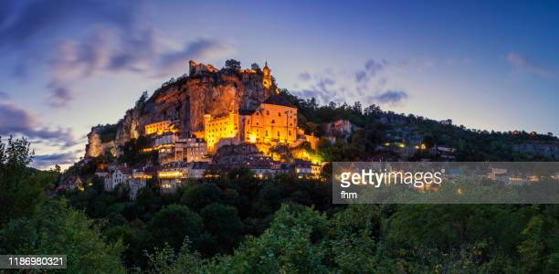 old town of rocamadour - panorama at sunset (lot/ france) - rocamadour stock pictures, royalty-free photos & images