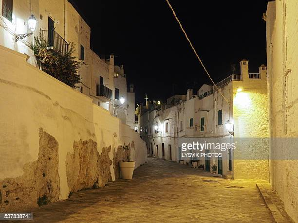 old town ostuni during twilight - ostuni stock photos and pictures