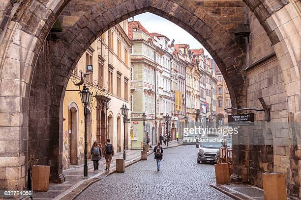 old town prague seen from charles bridge tower gate - charles bridge stock photos and pictures