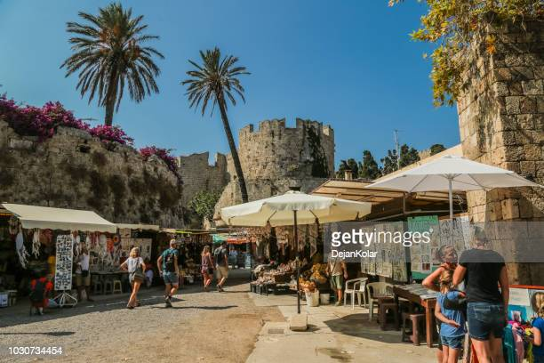 old town, rhodes, greece - wall and trench around fortress - old town stock pictures, royalty-free photos & images