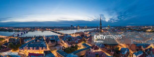 old town riga panorama after sunset - capital cities stock pictures, royalty-free photos & images