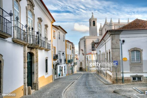 Old Town Street and The Capela dos Ossos (Chapel of Bones) in Évora, Portugal.