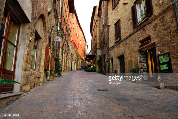 old town street in volterra, italy - volterra stock photos and pictures