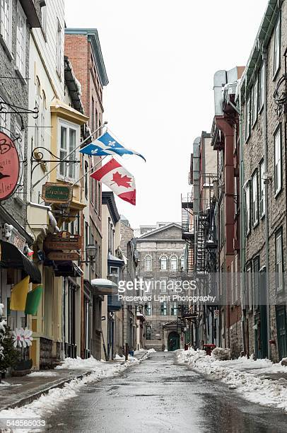 Old town street with Canadian and Quebec flags, Quebec City, Quebec, Canada