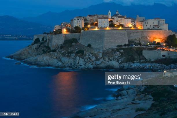 old town with citadel at dusk, calvi, haute-corse, corsica, france - peter forte - fotografias e filmes do acervo