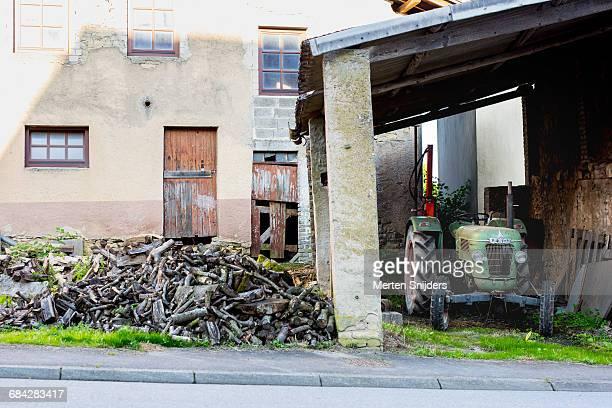 old tractor and woodpile - moselle stockfoto's en -beelden