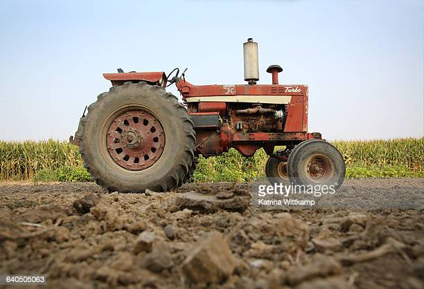 old tractor on iowa farm. - tractor stock pictures, royalty-free photos & images