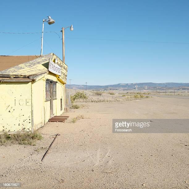Old trading post in desert landscape of Utah.