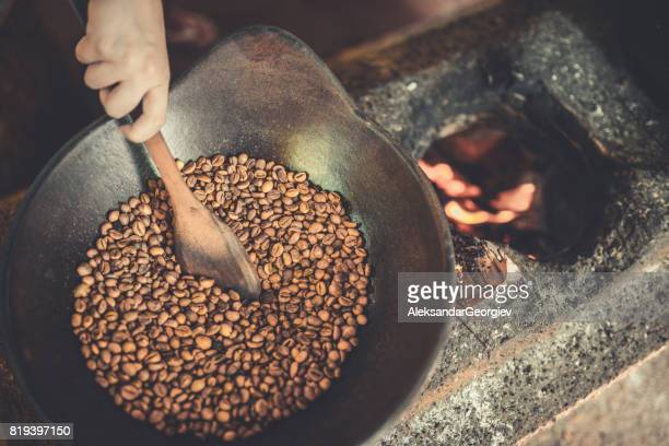 old traditional way of roasting raw coffee beans on fire - image technique stock pictures, royalty-free photos & images