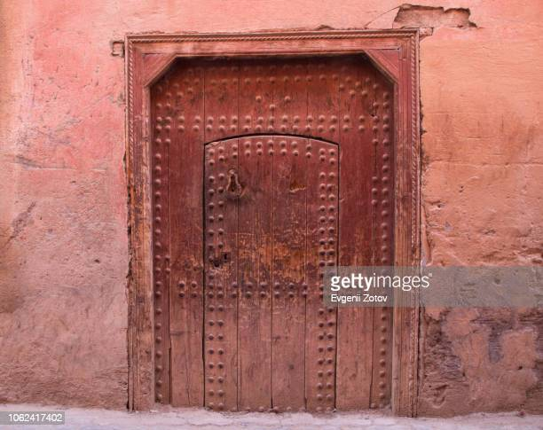 old traditional wooden red door of a house in taroudant, morocco - moroccan culture stock pictures, royalty-free photos & images